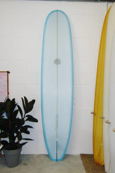 Underside of the classic single fin longboard 'The Cali Square Tail' by Cooper Surfboards